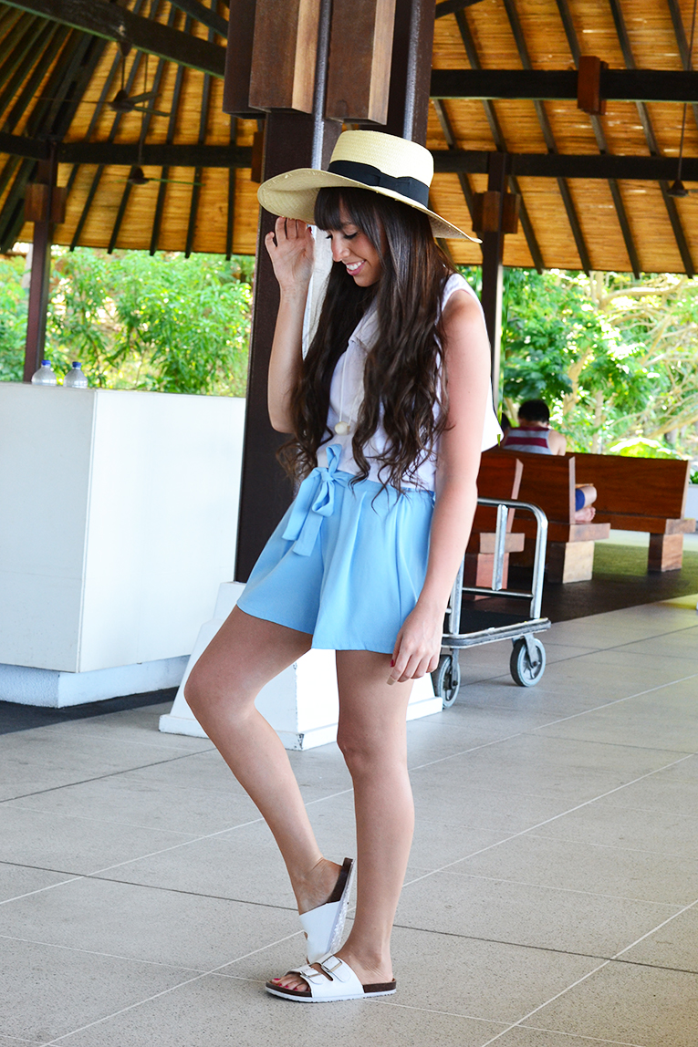 Batam Indonesia, Baby blue shorts with a bow, white crop top with open back, white ugly shoes, big hat