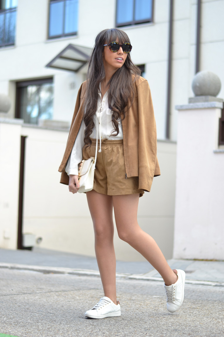 Suede shorts, suede jacket, White shirt with lace-up, wildfox sunglasses, white sneakers, street style