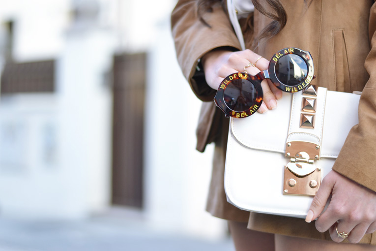 suede jacket, wildfox sunglasses, white clutch with golden details, street style