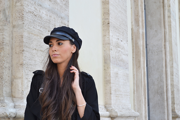 Military cap, fluid black trench, white sneakers, lace skirt, rome, italy