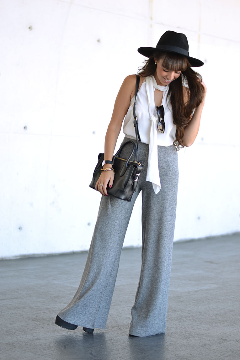 Street style, autumn trends, knit flared pants, skinny scarf, bow blouse, black hat, cat eye sunglasses, mercedes benz fashion week outfit