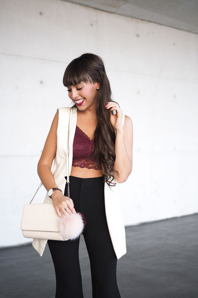 Street style, extra flared pants, lace top, long vest, pom pom bag, MBFW