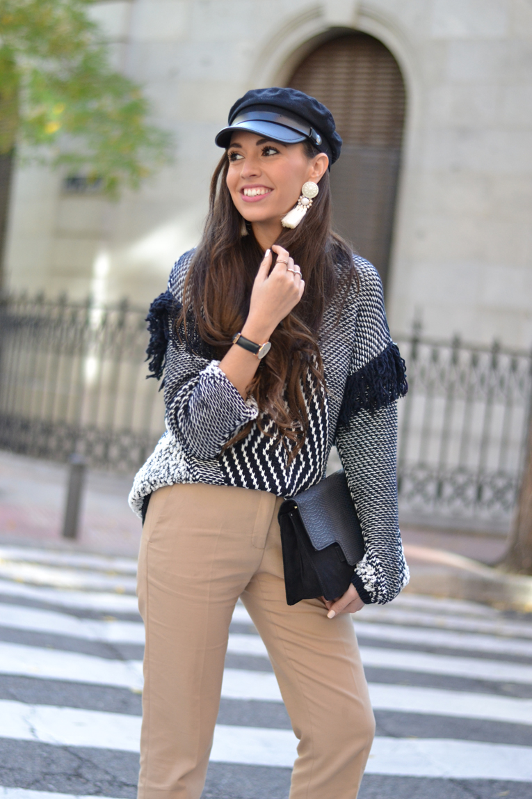 Street style, military cap, cozy sweater, big earings, black sneakers, winter outfit