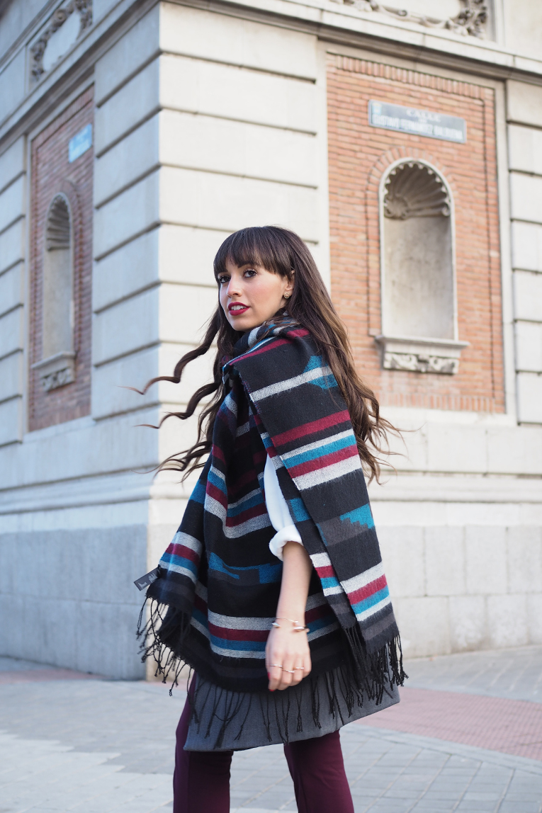 Street style, winter outfit, flared pants, burgundy, ethnic scarf, vest