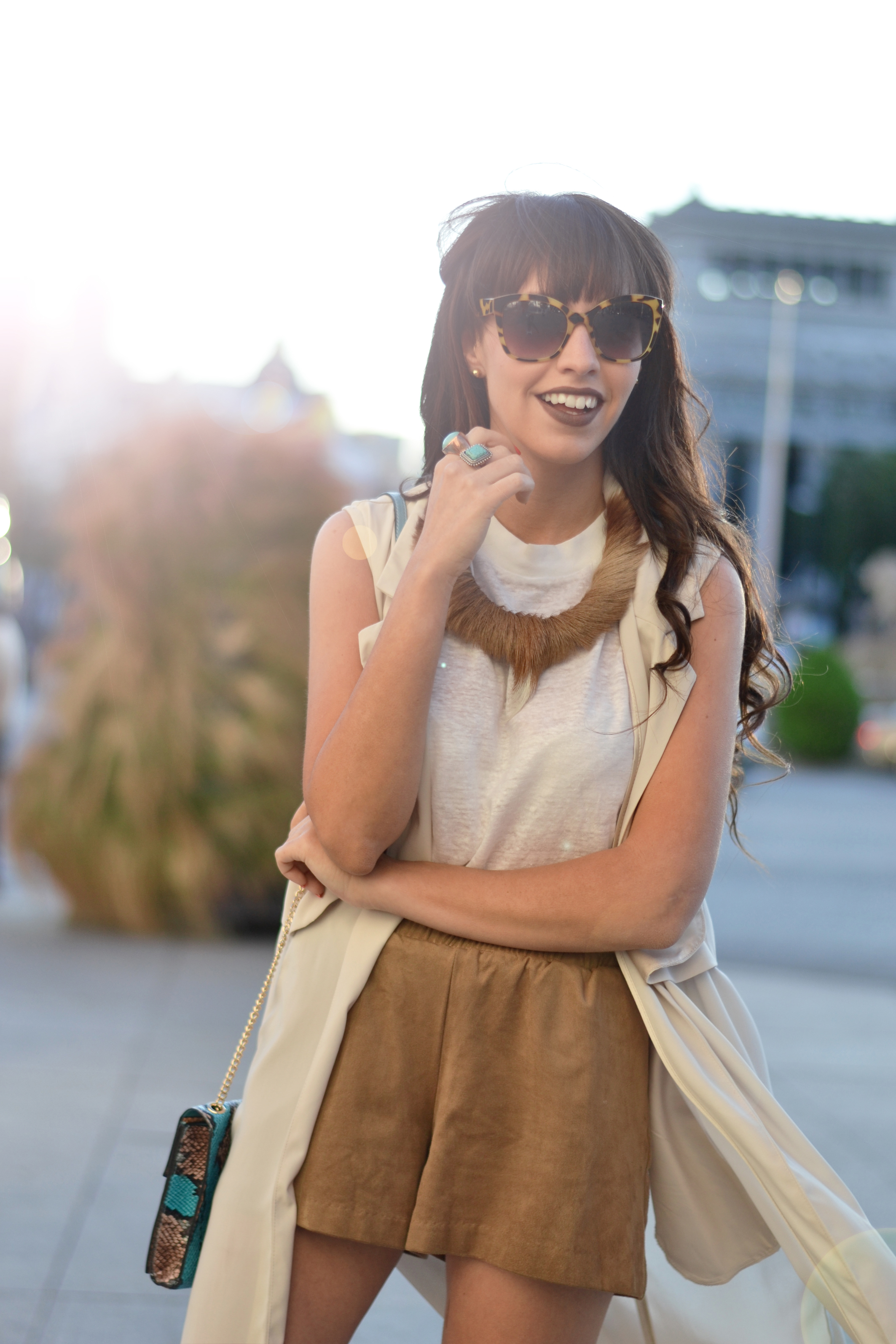 Street style, long trench vest, suede shorts, summer outfit