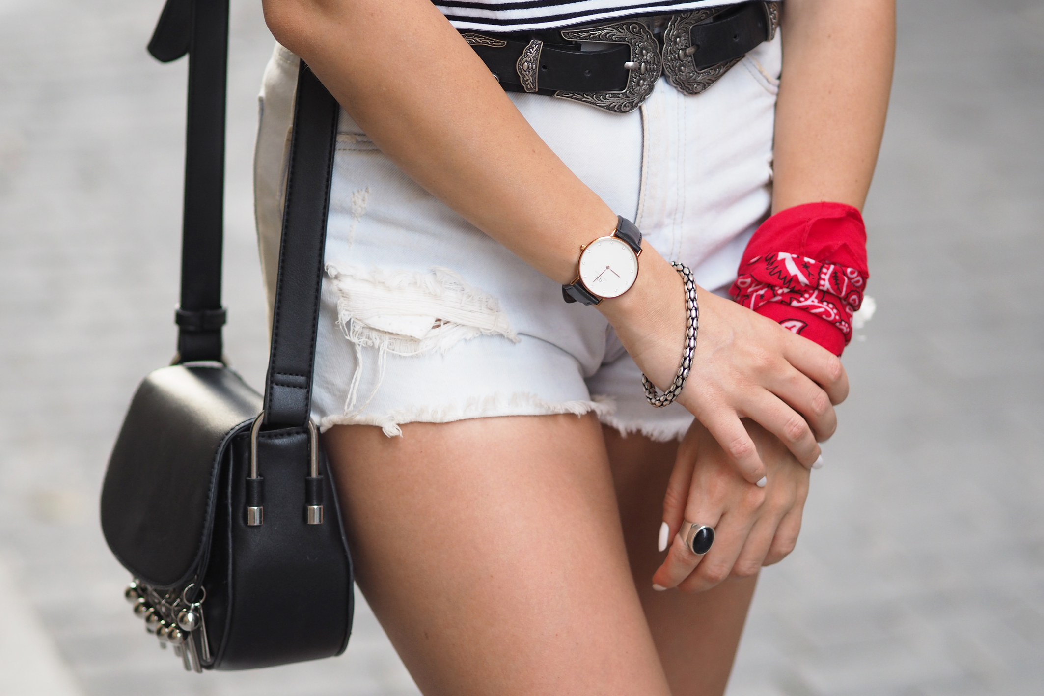 Street style, details, double belt, bandana scarf, ripped denim shorts