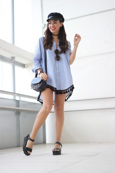 Street style, oversized trend, Striped shirt with pompoms, shirt dress, military black cap, chunky sandals