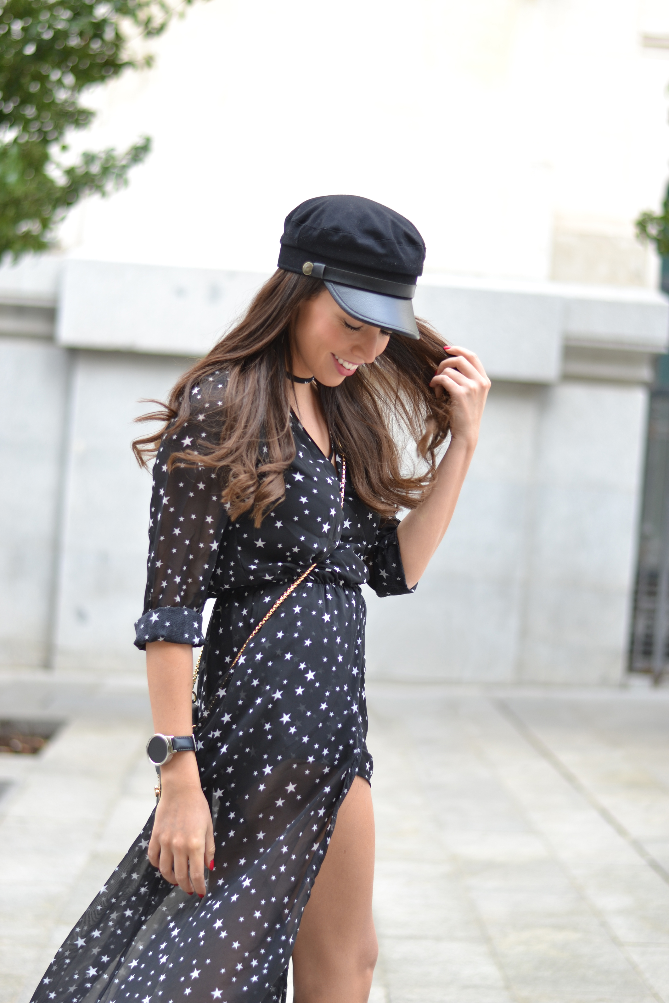Street style, black long dress, stars print, military cap, white sneakers