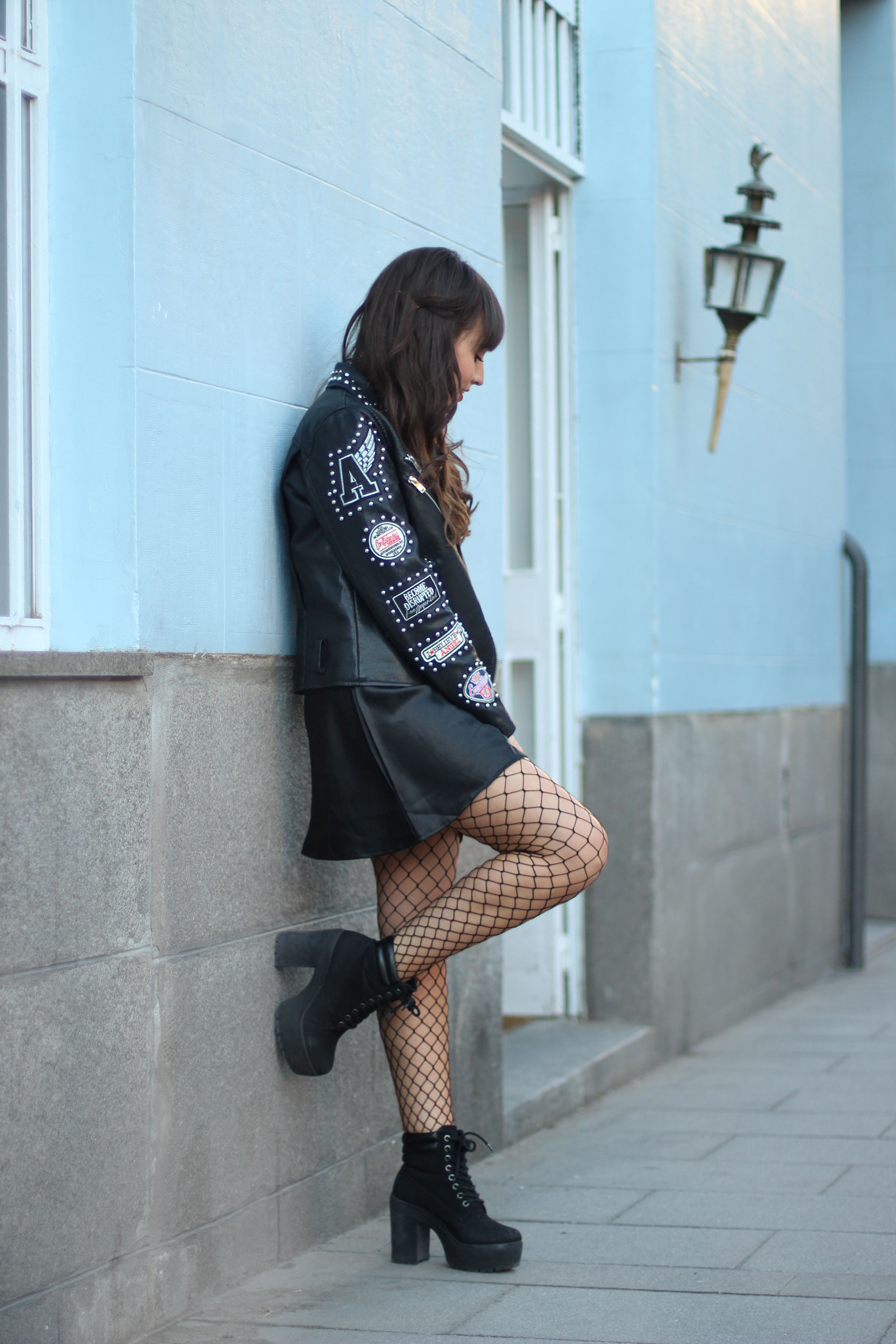 fishnet tights trend, lace dress, leather patch jacket, street style